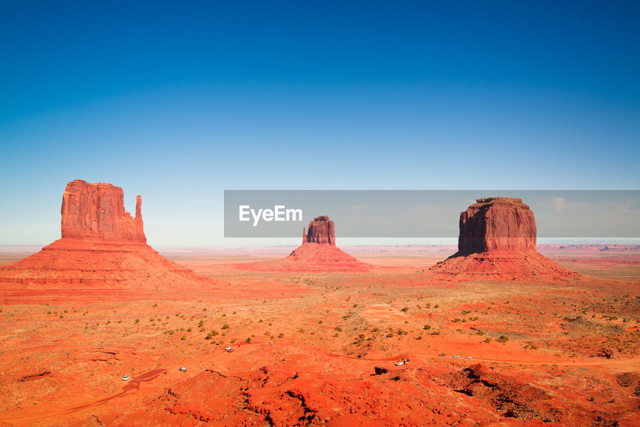 Rock Formations At Monument Valley Against Clear Blue Sky