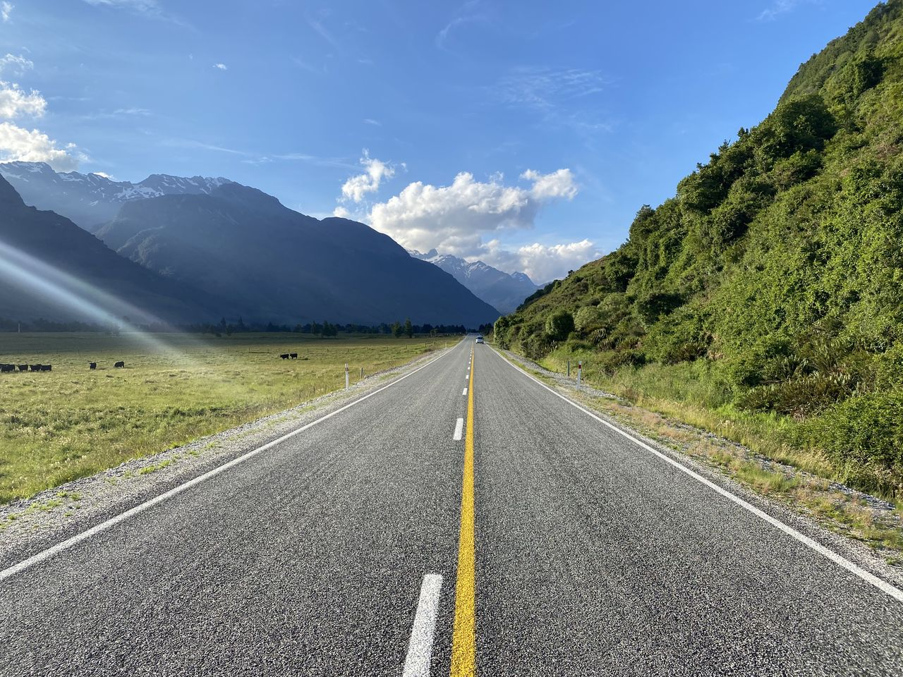 road, transportation, mountain, sky, marking, road marking, the way forward, direction, symbol, sign, diminishing perspective, beauty in nature, nature, cloud - sky, mountain range, no people, non-urban scene, tranquil scene, empty road, tranquility, outdoors, dividing line