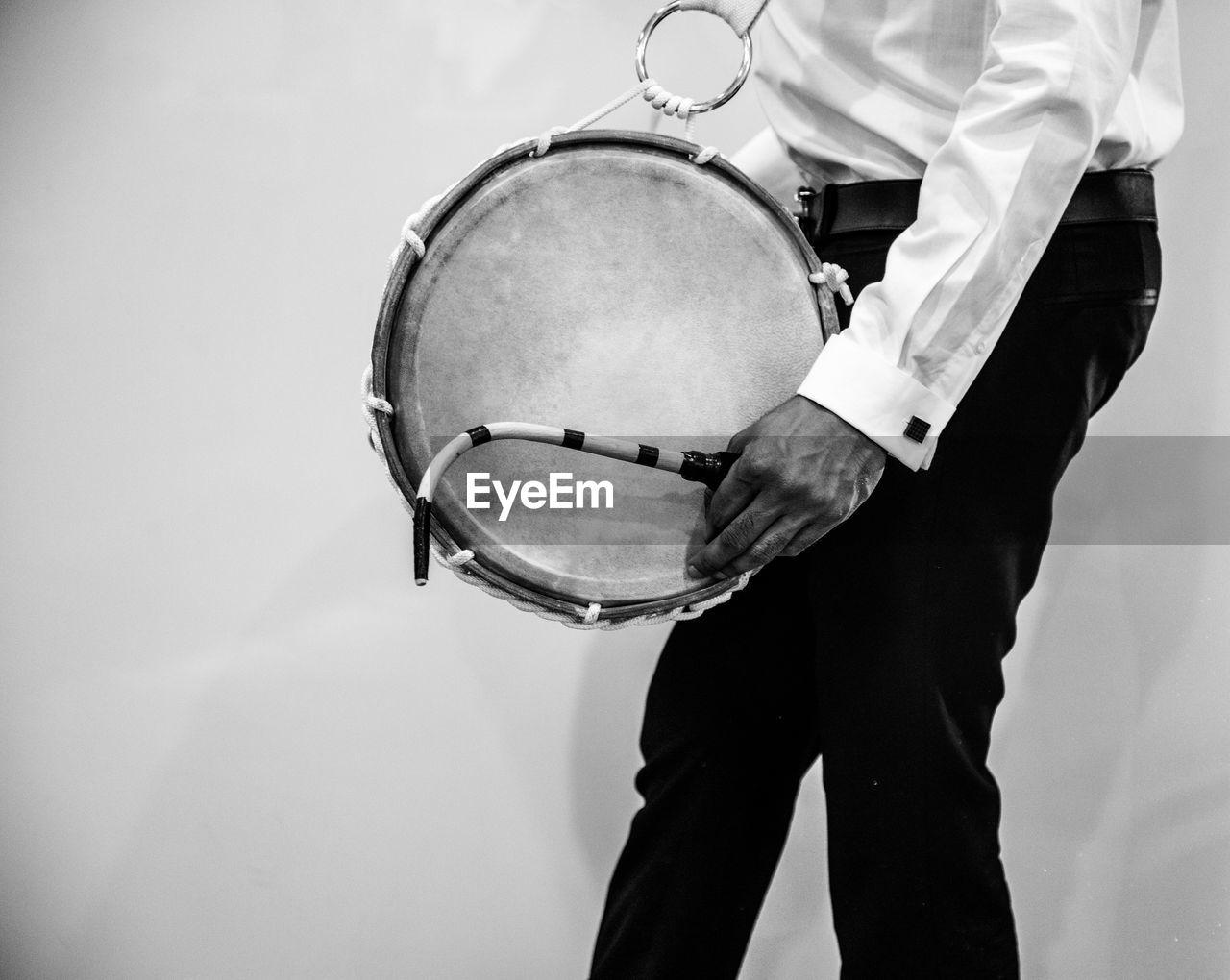 Man playing indian drum