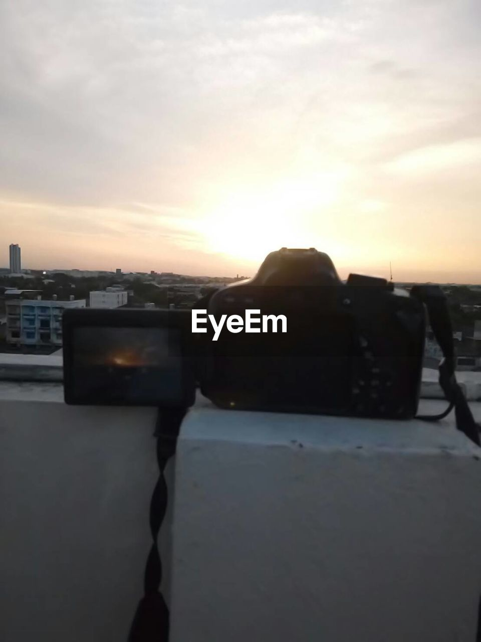 sunset, sky, technology, photography themes, photographing, camera - photographic equipment, cloud - sky, architecture, outdoors, close-up, built structure, building exterior, wireless technology, city, nature, no people, cityscape, digital single-lens reflex camera, day