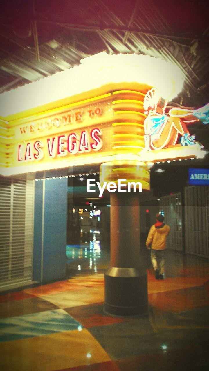 illuminated, text, indoors, communication, night, no people, architectural column, architecture, neon