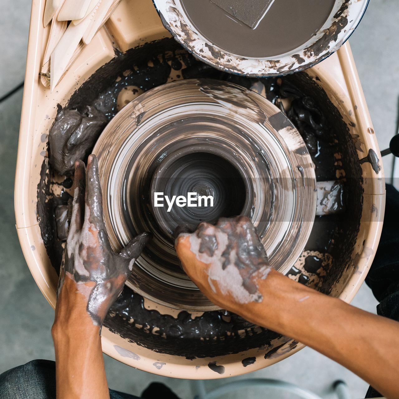 CLOSE-UP OF WOMAN HAND IN WATER TANK