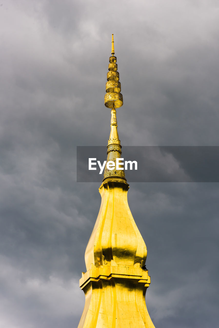 sky, cloud - sky, architecture, religion, belief, built structure, spirituality, gold colored, travel destinations, building, low angle view, no people, place of worship, nature, spire, tower, building exterior, tourism, gold, outdoors