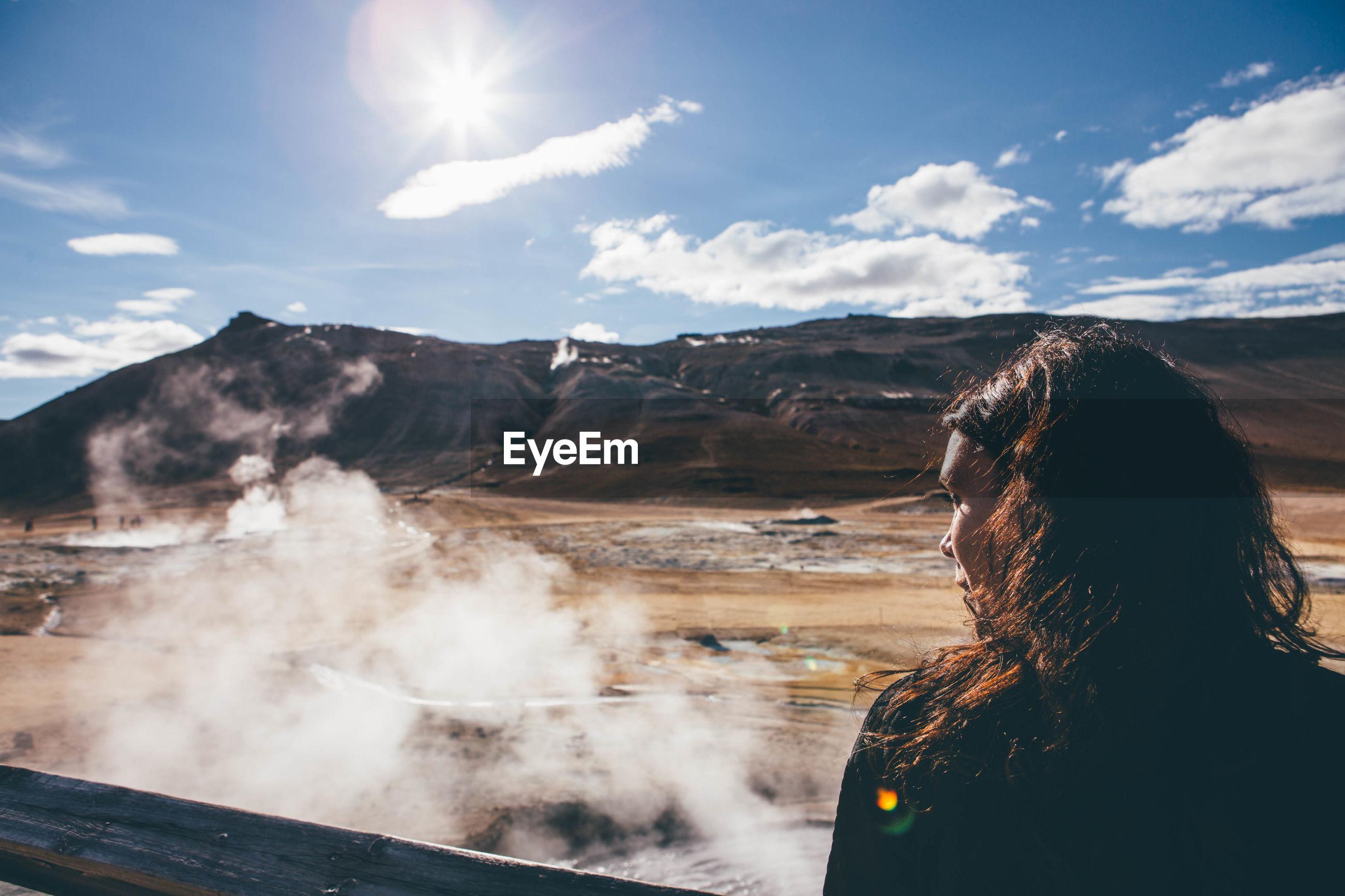 Woman on landscape against sky