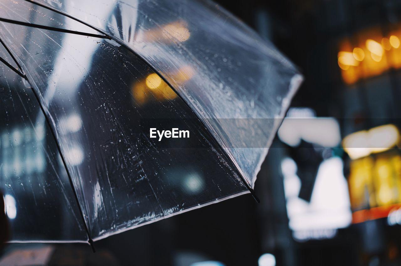 Close-Up Of Wet Umbrella During Rainy Season
