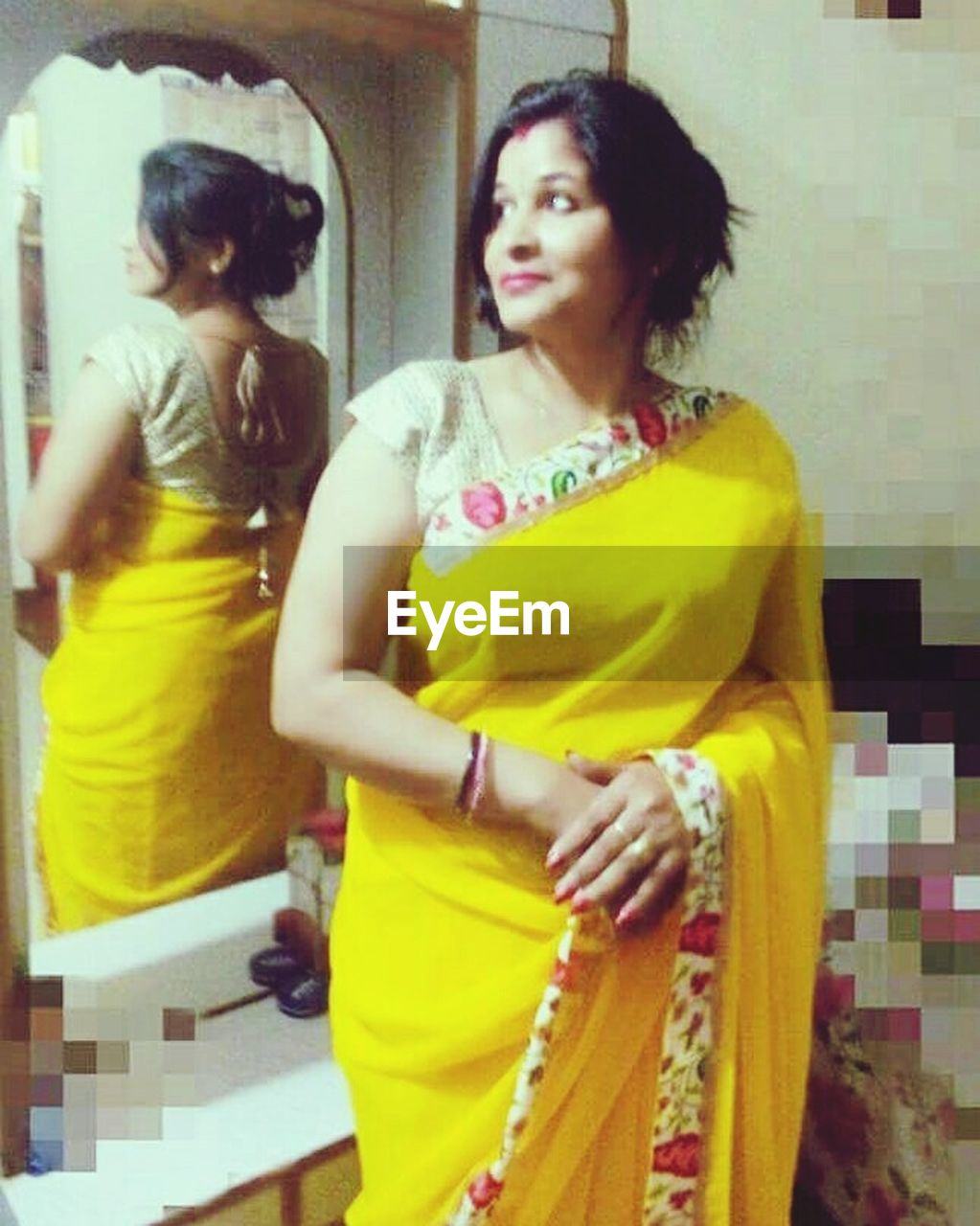 yellow, standing, three quarter length, sari, lifestyles, mid adult, two people, leisure activity, casual clothing, togetherness, young adult, real people, portrait, young women, indoors, day, smiling, beautiful woman, happiness, friendship, adult, people, adults only, abdomen