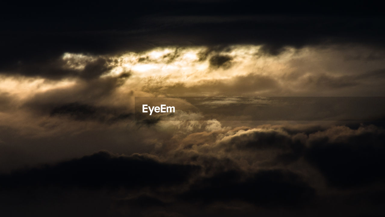 cloud - sky, sky, beauty in nature, scenics - nature, tranquility, tranquil scene, no people, idyllic, low angle view, nature, sunset, cloudscape, dramatic sky, outdoors, storm, backgrounds, moody sky, majestic, storm cloud, dark, meteorology