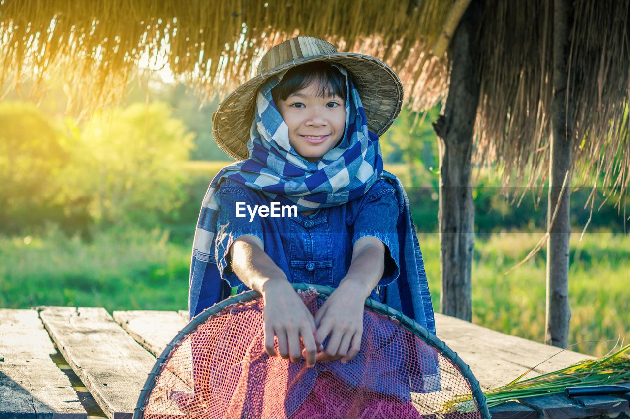 Portrait Of Smiling Girl Standing In Farm