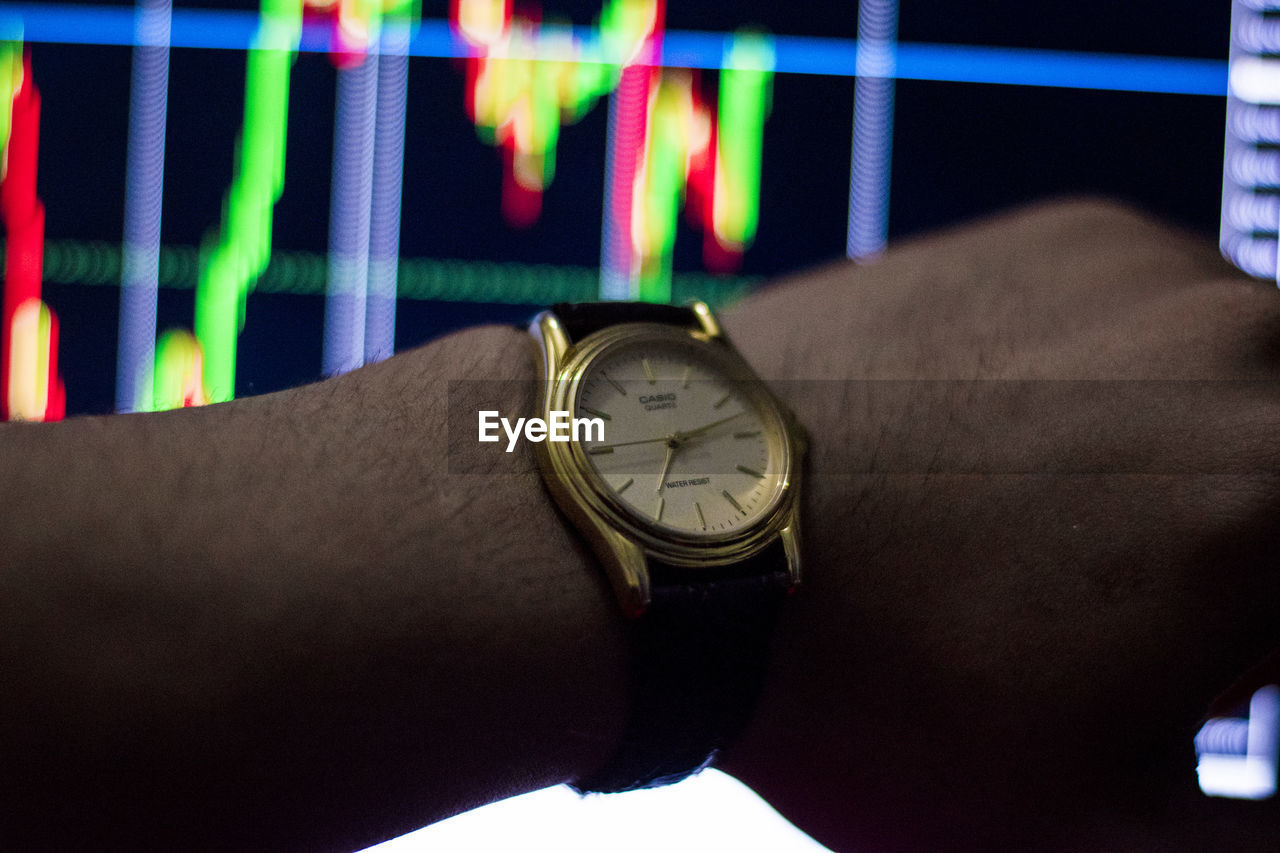 human hand, time, hand, one person, watch, human body part, wristwatch, real people, lifestyles, body part, clock, close-up, men, indoors, instrument of time, multi colored, personal perspective, leisure activity, unrecognizable person, finger, personal accessory, wrist, human limb, checking the time