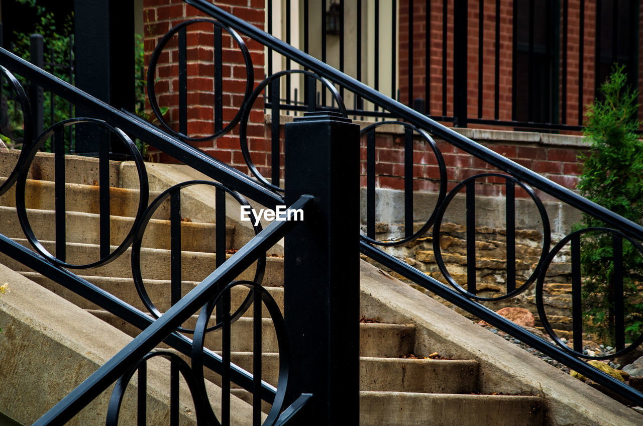railing, architecture, staircase, built structure, metal, steps and staircases, day, no people, building, building exterior, spiral, focus on foreground, outdoors, pattern, house, absence, nature, empty, close-up, moving up