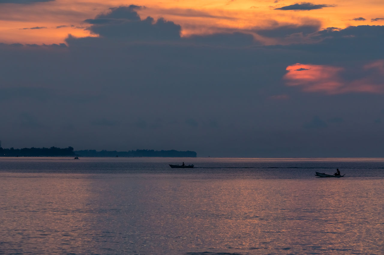 sunset, beauty in nature, nature, sea, scenics, nautical vessel, transportation, water, sky, waterfront, mode of transport, tranquility, cloud - sky, tranquil scene, outdoors, silhouette, horizon over water, sailing, no people, jet boat, day