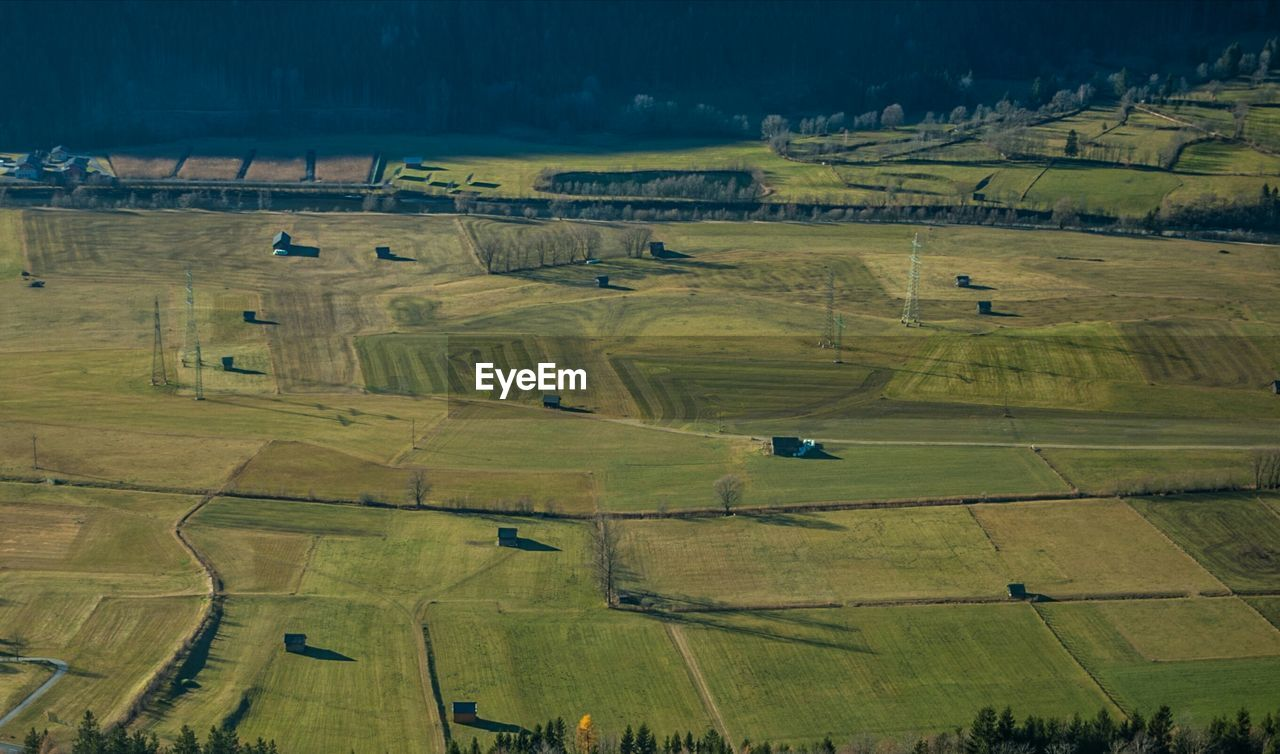 landscape, field, agriculture, rural scene, beauty in nature, nature, tranquil scene, farm, patchwork landscape, aerial view, tranquility, scenics, no people, outdoors, day, green color, grass, sky