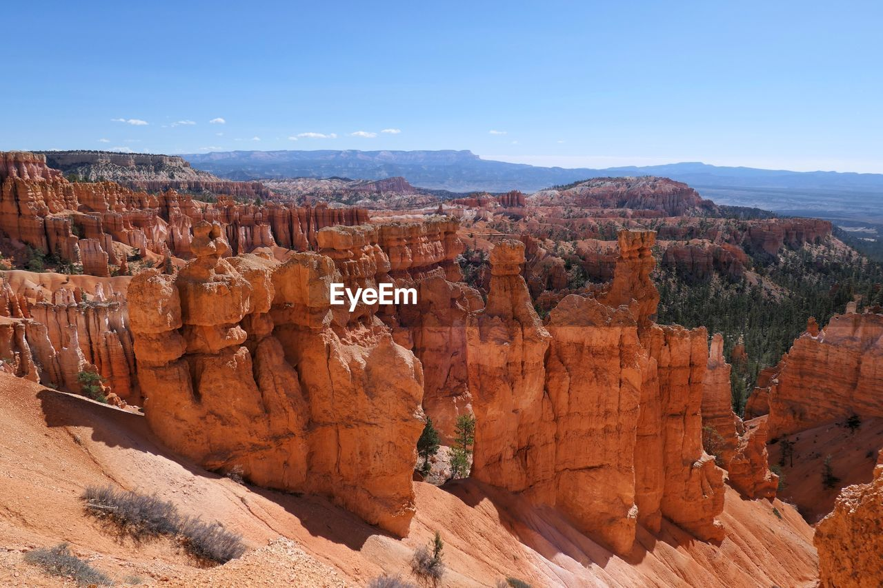 sky, rock, beauty in nature, rock formation, scenics - nature, non-urban scene, rock - object, tranquil scene, travel destinations, mountain, geology, tranquility, physical geography, travel, nature, solid, idyllic, remote, no people, environment, mountain range, eroded, outdoors, climate, formation, arid climate