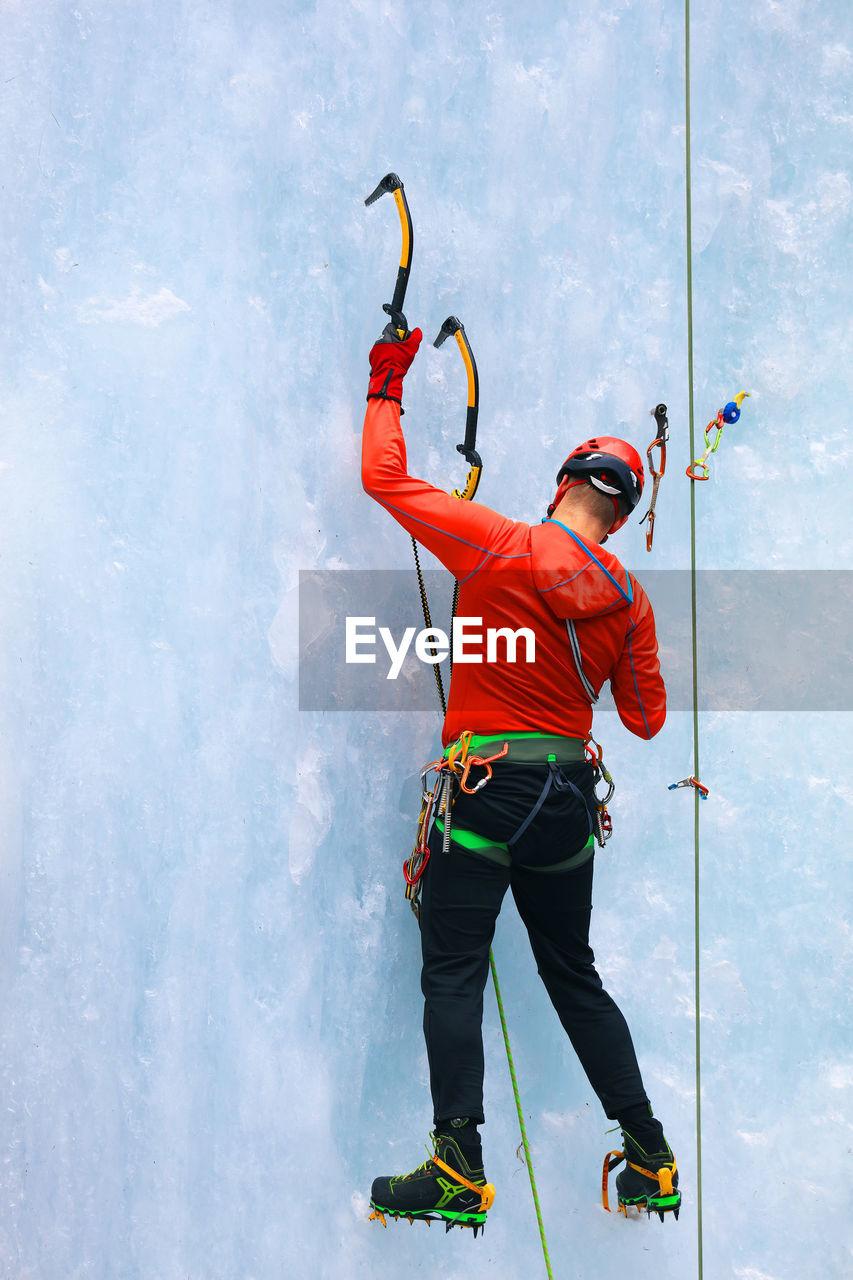 Full Length Of Man Climbing Glacier