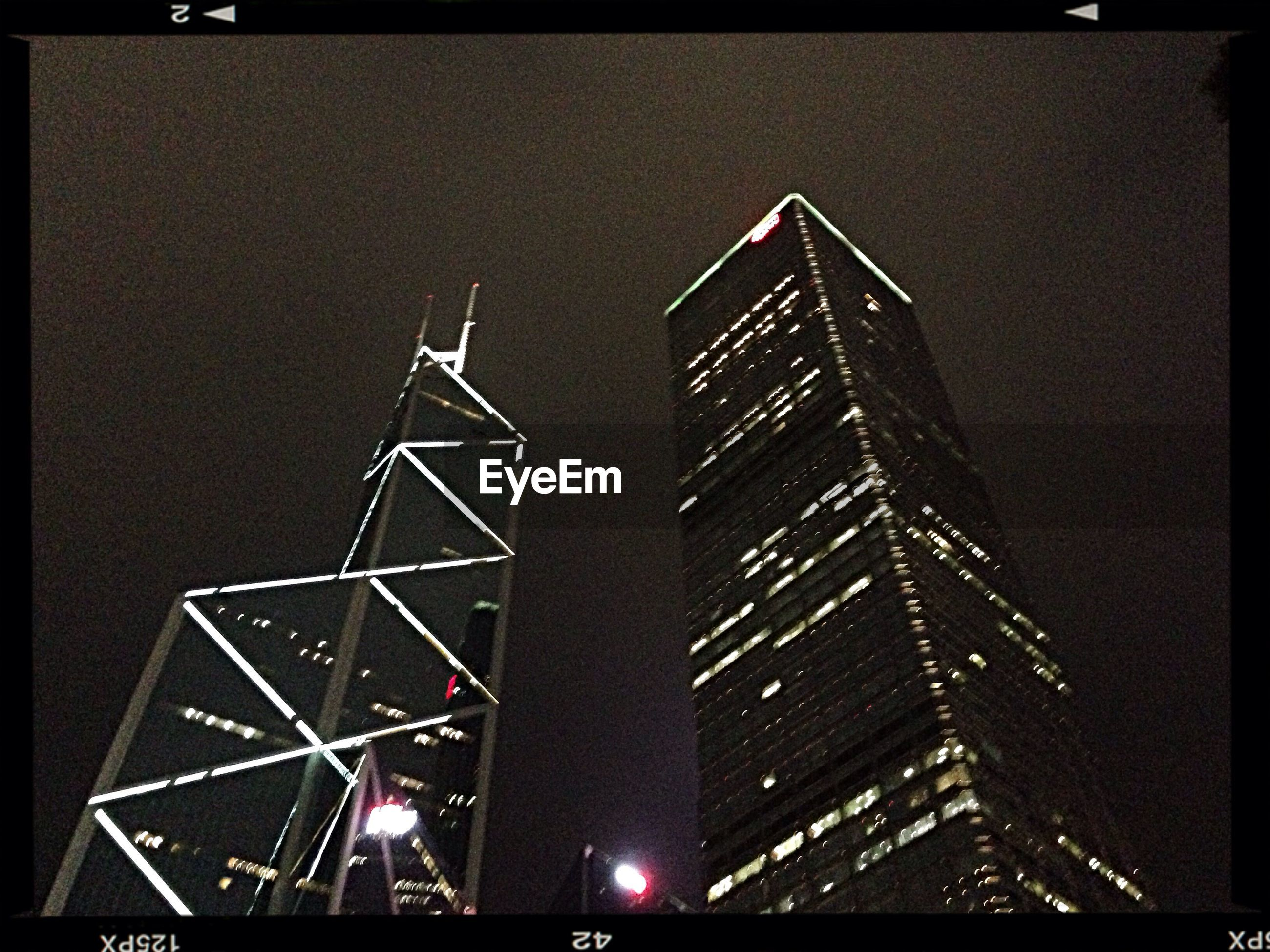 low angle view, architecture, built structure, night, illuminated, transfer print, building exterior, tower, tall - high, city, auto post production filter, clear sky, skyscraper, sky, modern, tall, no people, outdoors, development, capital cities