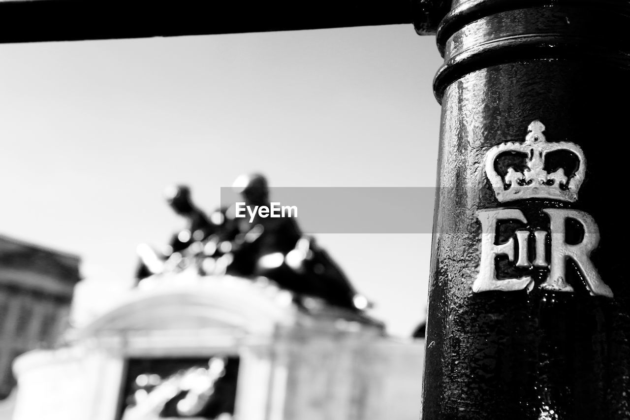communication, focus on foreground, close-up, low angle view, outdoors, day, no people, sky