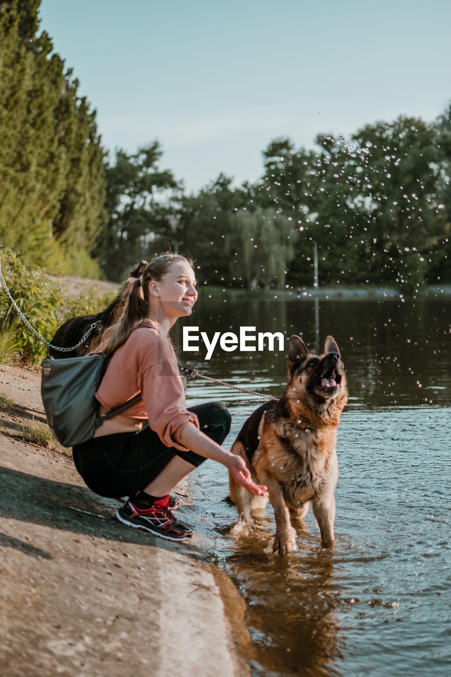 Full length of dog on water