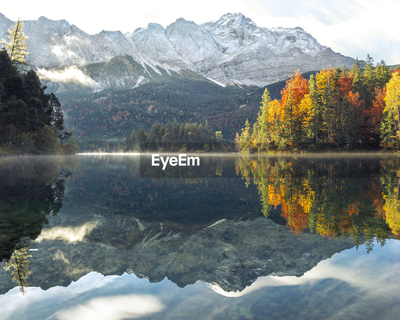 reflection, mountain, nature, beauty in nature, water, scenics, lake, tranquil scene, tranquility, tree, autumn, mountain range, day, waterfront, outdoors, snow, no people, sky, winter