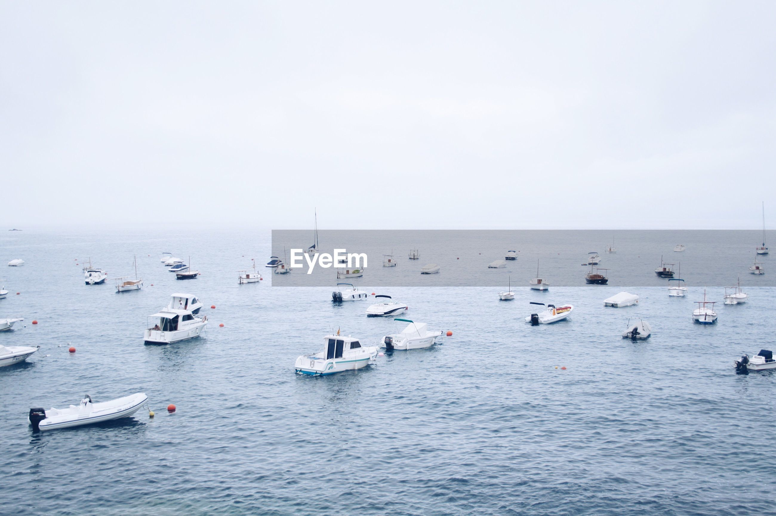 View of boats moving in sea