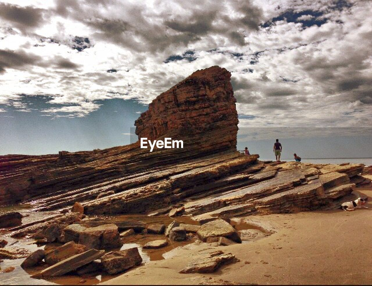 rock formation, rock - object, sky, nature, cloud - sky, real people, cliff, landscape, beauty in nature, day, physical geography, scenics, outdoors, women, one person, people