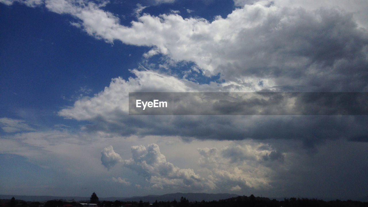 Silhouette Landscape Against Cloudy Sky