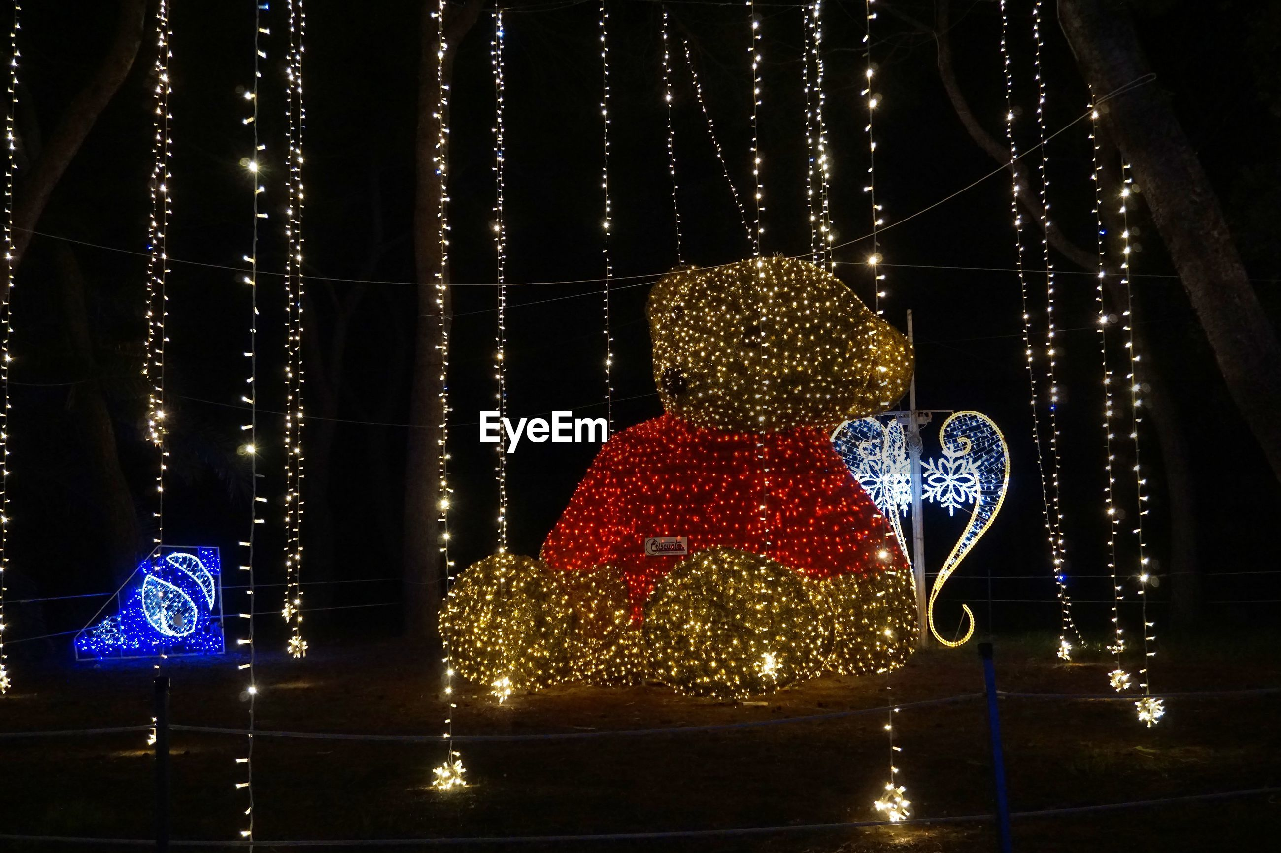ILLUMINATED CHRISTMAS TREE AT NIGHT DURING FESTIVAL