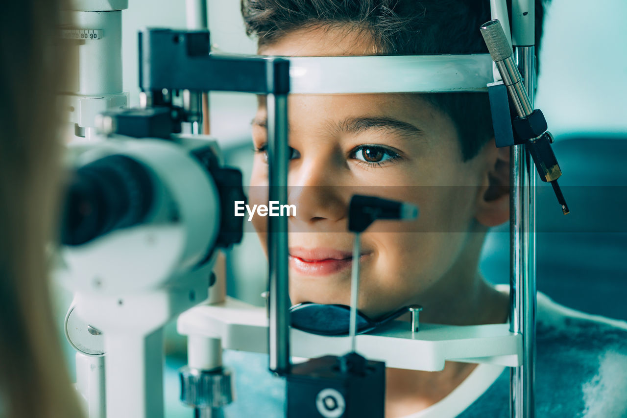 Close-Up Of Ophthalmologist Doing Eye Test Of Boy