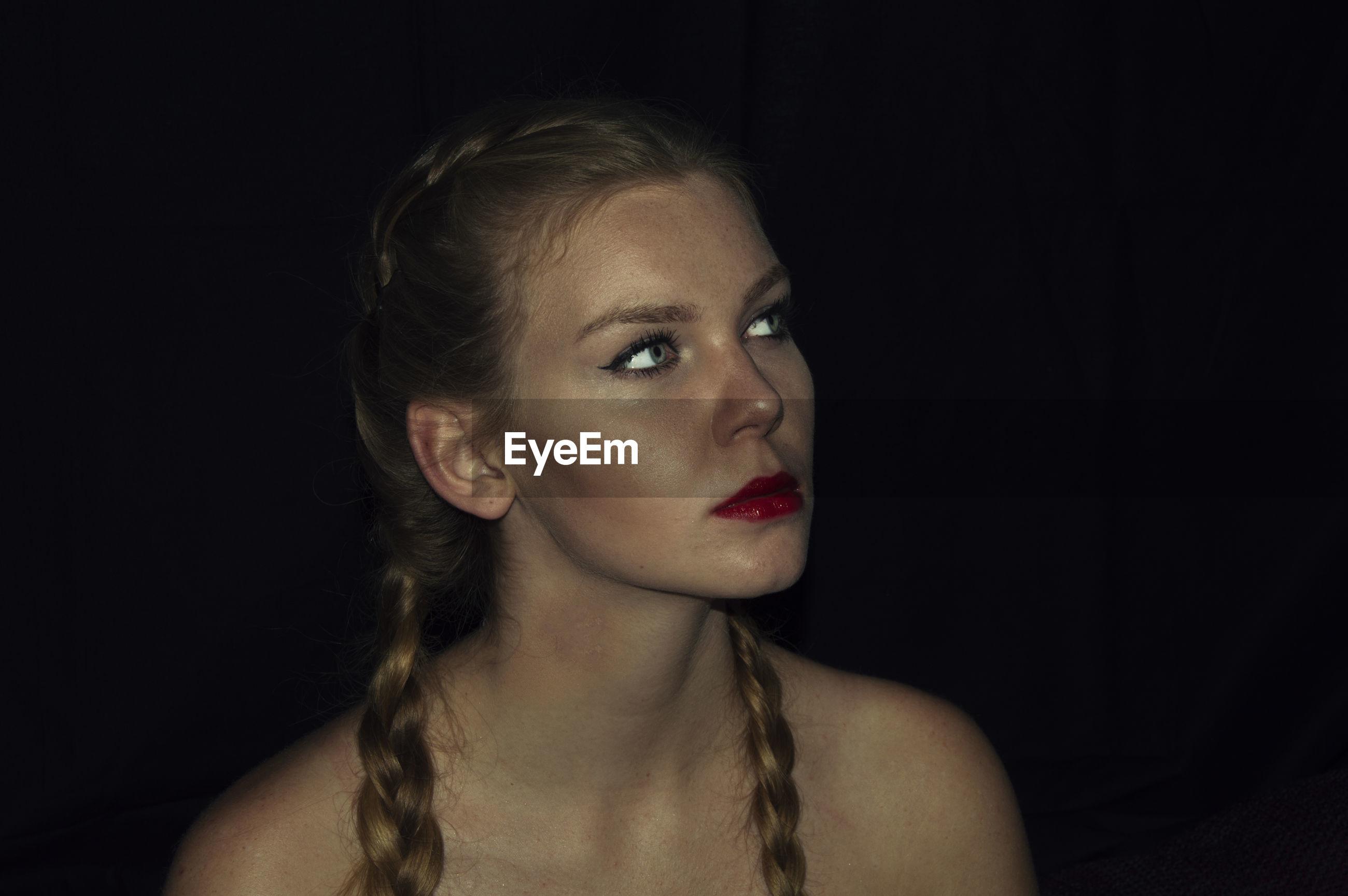 Beautiful young woman in darkroom