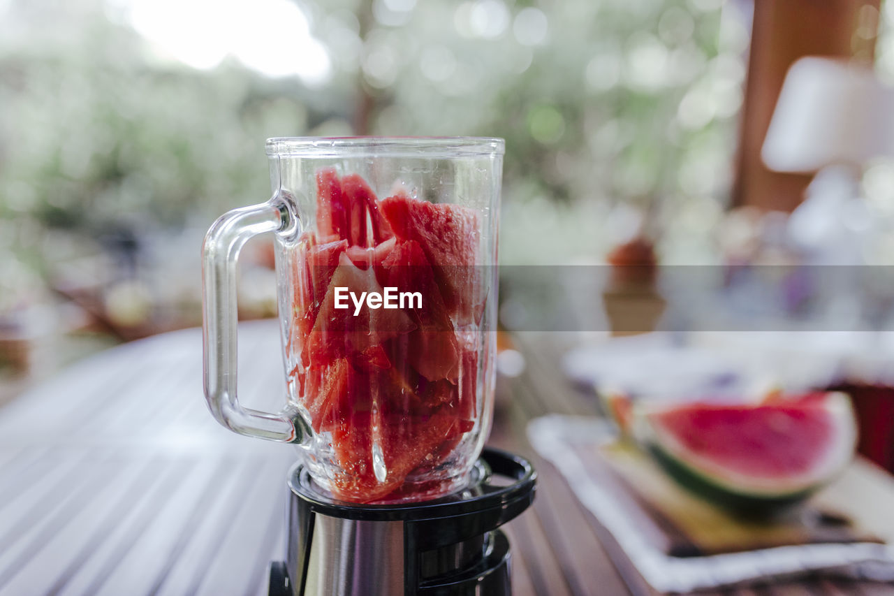 food and drink, red, glass, food, freshness, drink, focus on foreground, close-up, household equipment, drinking glass, healthy eating, strawberry, no people, fruit, berry fruit, refreshment, glass - material, table, wellbeing, indoors, temptation