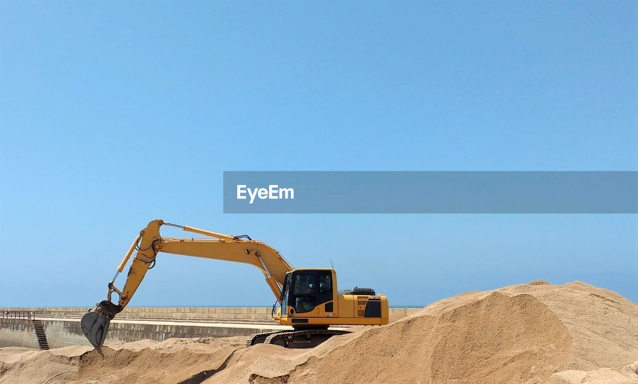 Digger On Construction Site Against Clear Sky