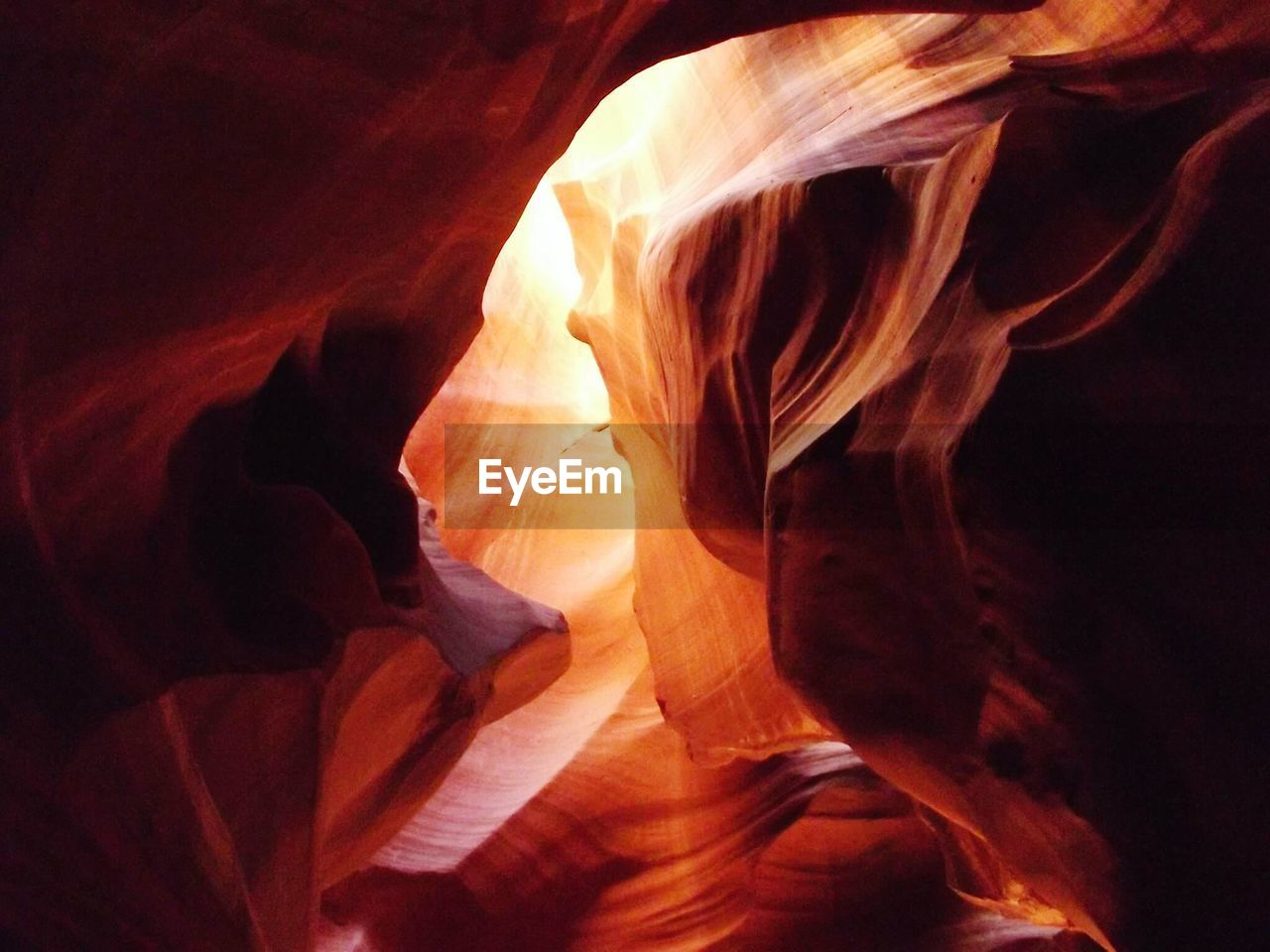 indoors, beauty in nature, nature, no people, rock, physical geography, rock - object, rock formation, orange color, canyon, geology, solid, non-urban scene, flame, motion, natural pattern, travel destinations, fire, textured, eroded, sandstone