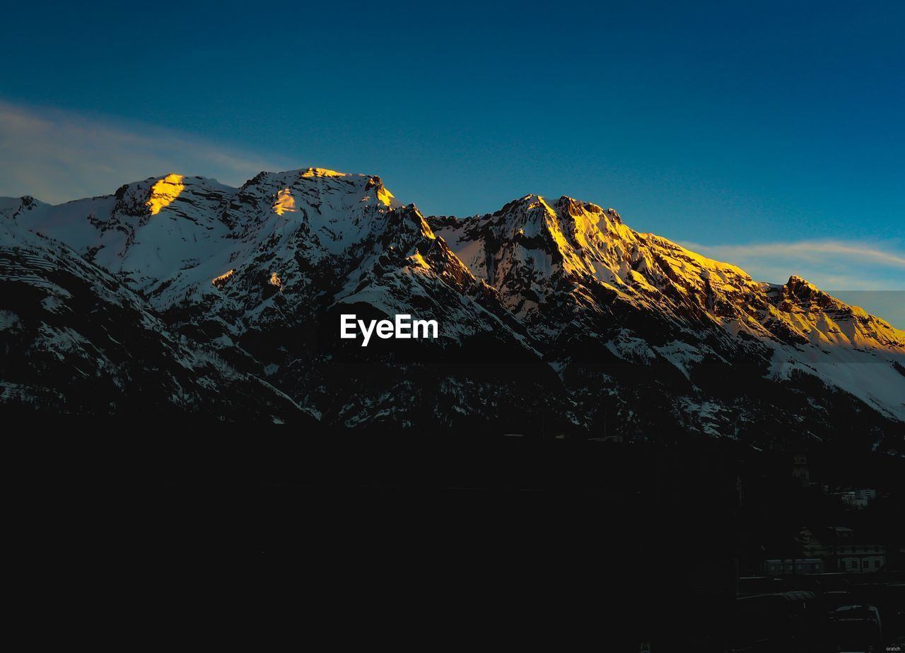 mountain, sky, scenics - nature, beauty in nature, mountain range, tranquil scene, tranquility, snow, no people, snowcapped mountain, environment, winter, landscape, cold temperature, nature, non-urban scene, physical geography, idyllic, mountain peak, day, outdoors, formation