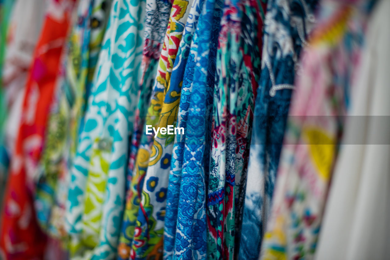 Full frame shot of multi colored textiles hanging in store