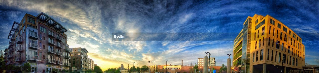 building exterior, architecture, built structure, cloud - sky, sky, city, low angle view, outdoors, window, no people, sunset, panoramic, day, cityscape