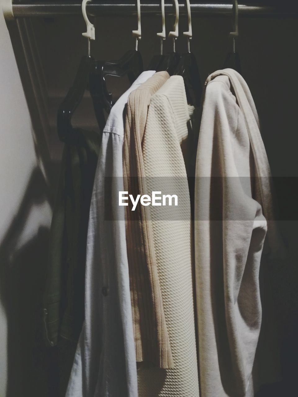 hanging, coathanger, rack, indoors, clothing, no people, textile, in a row, still life, clothes rack, close-up, variation, closet, choice, furniture, business, button down shirt, side by side, fashion, order, menswear, garment