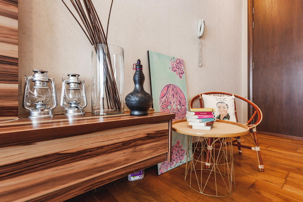 table, indoors, wood - material, no people, container, home interior, bottle, still life, seat, absence, chair, glass - material, wood, wall - building feature, hardwood floor, domestic room, transparent, food and drink, flooring, window, glass