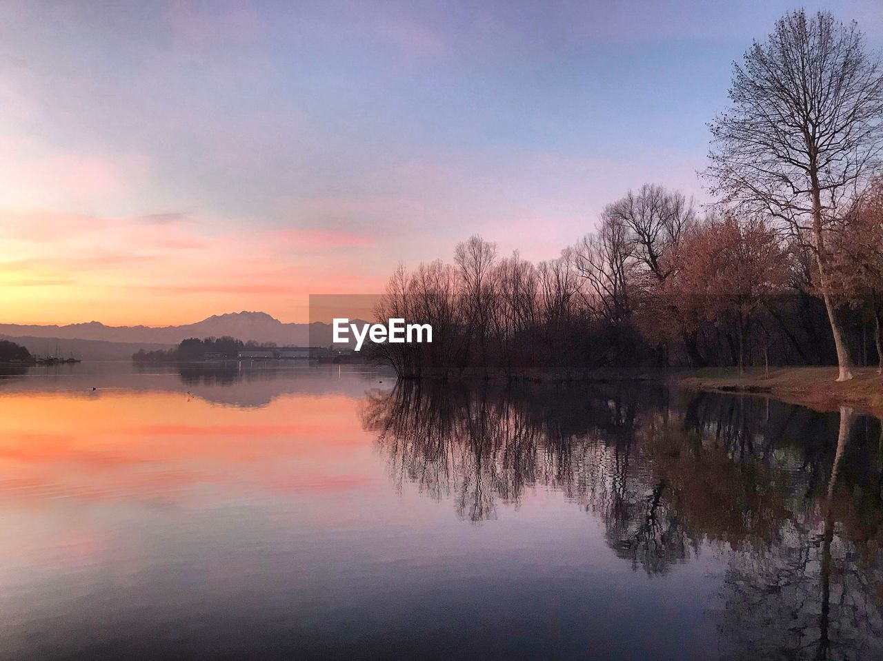 sky, reflection, water, tranquility, scenics - nature, lake, beauty in nature, tranquil scene, tree, sunset, waterfront, idyllic, plant, non-urban scene, no people, nature, cloud - sky, orange color, outdoors, reflection lake