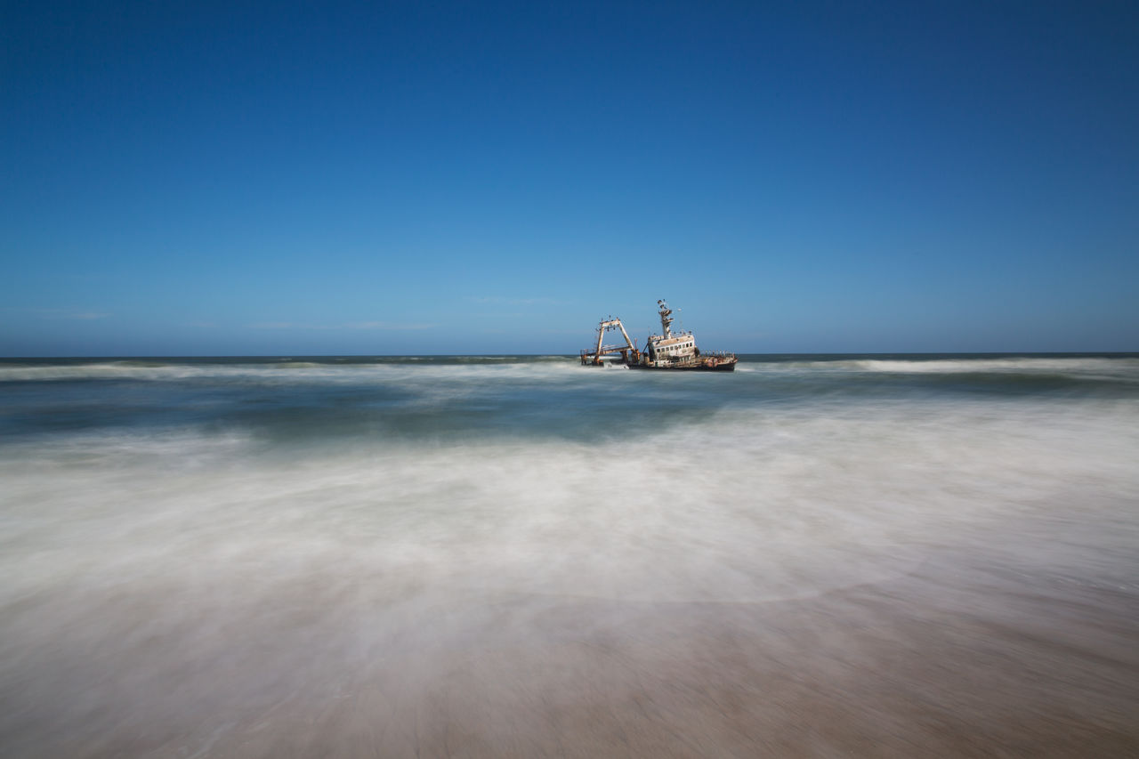 sea, water, sky, horizon over water, horizon, nautical vessel, blue, nature, scenics - nature, offshore platform, no people, day, industry, transportation, clear sky, oil industry, drilling rig, beauty in nature, fuel and power generation, outdoors