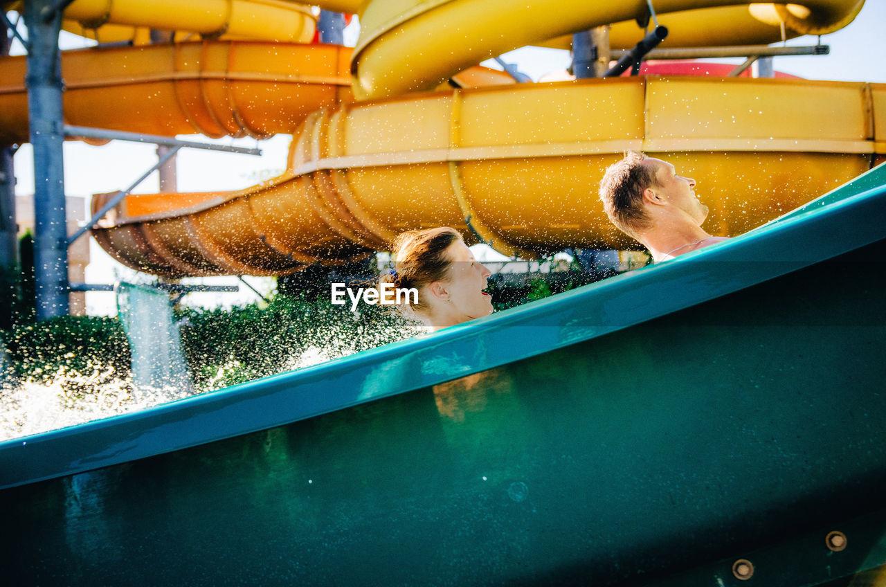 Happy Couple Enjoying Water Slide