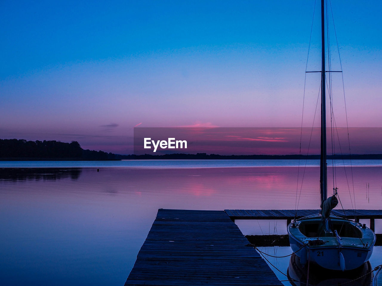 water, sky, nautical vessel, beauty in nature, scenics - nature, sunset, reflection, tranquility, tranquil scene, transportation, nature, pier, mode of transportation, moored, sea, wood - material, no people, dusk, outdoors, sailboat