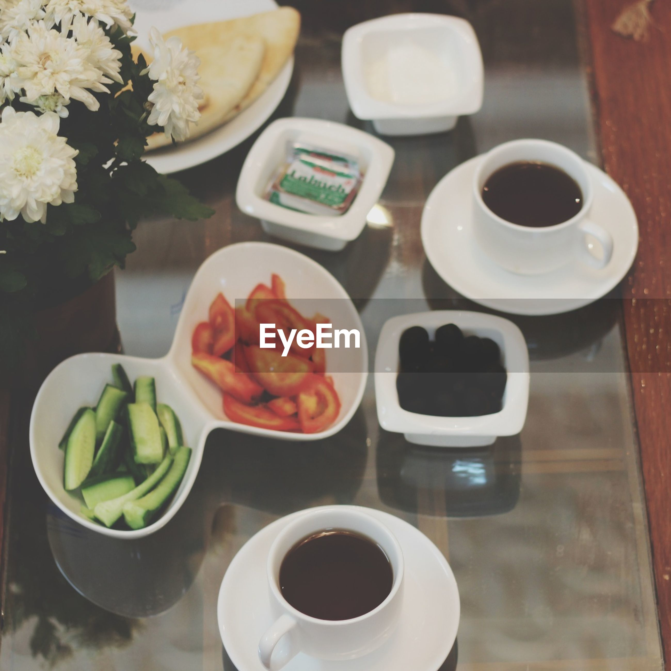 coffee cup, food and drink, indoors, drink, freshness, table, saucer, refreshment, coffee - drink, cup, plate, coffee, spoon, still life, healthy eating, tea cup, high angle view, breakfast, food, close-up