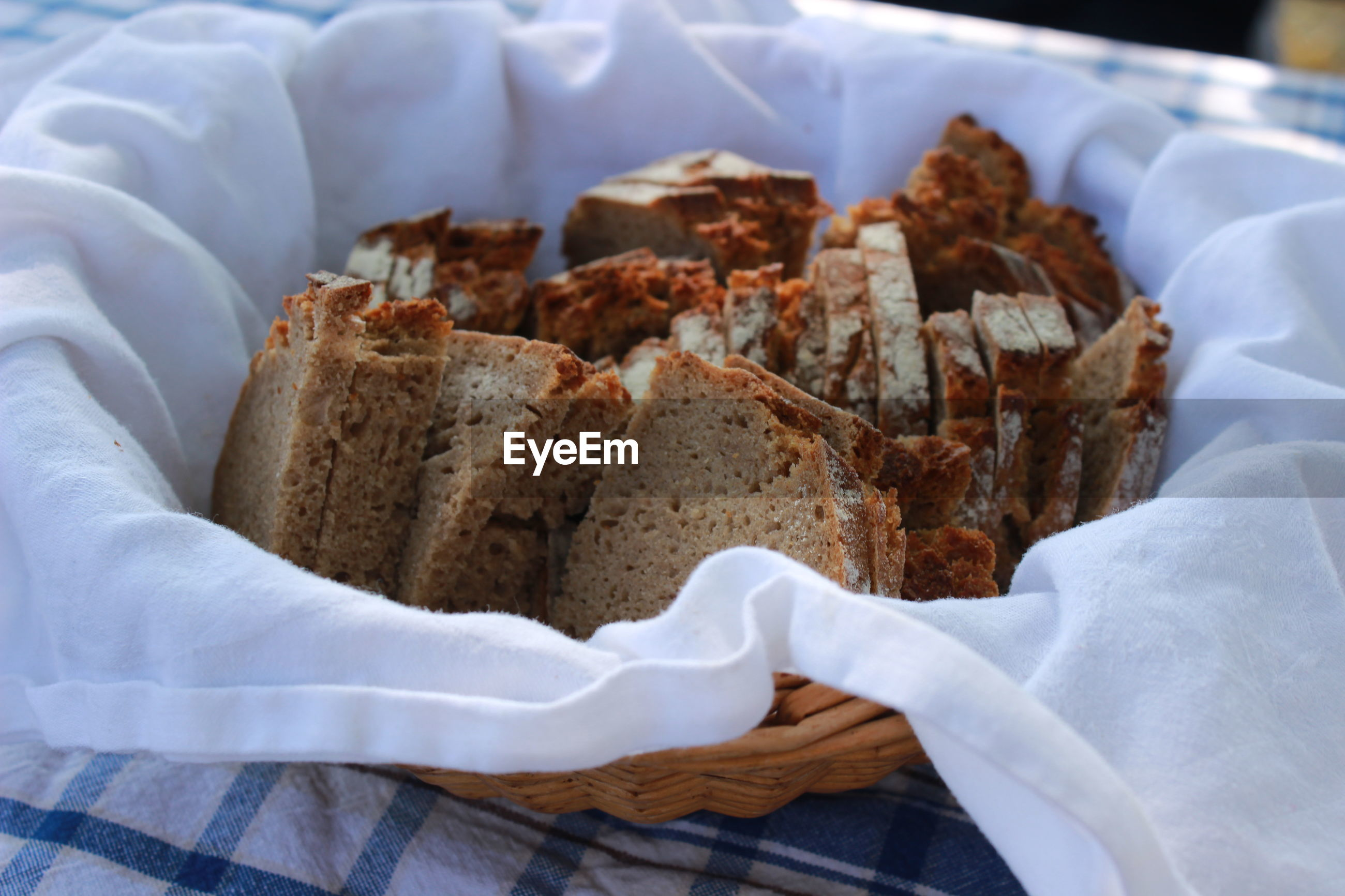 Close-up of bread slices in basket on table