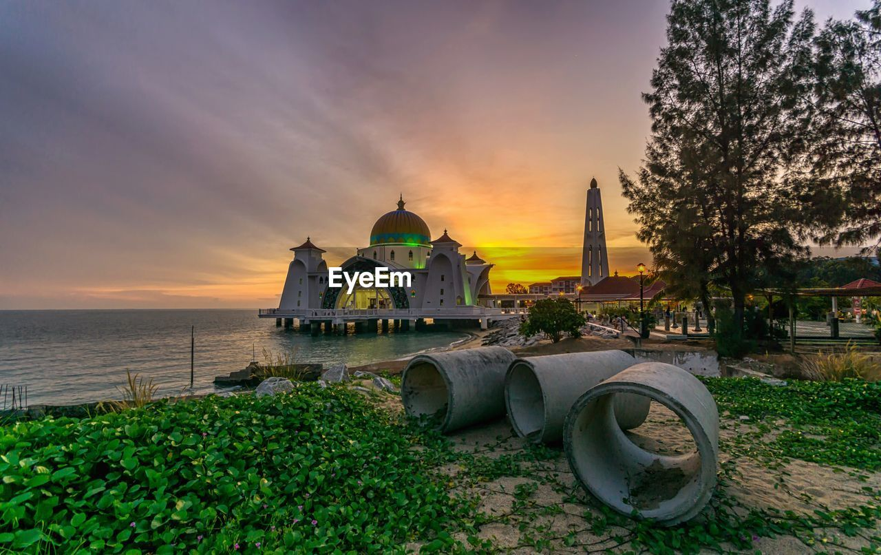 sunset, architecture, sky, water, religion, belief, built structure, place of worship, spirituality, plant, building exterior, nature, building, cloud - sky, no people, dome, orange color, outdoors