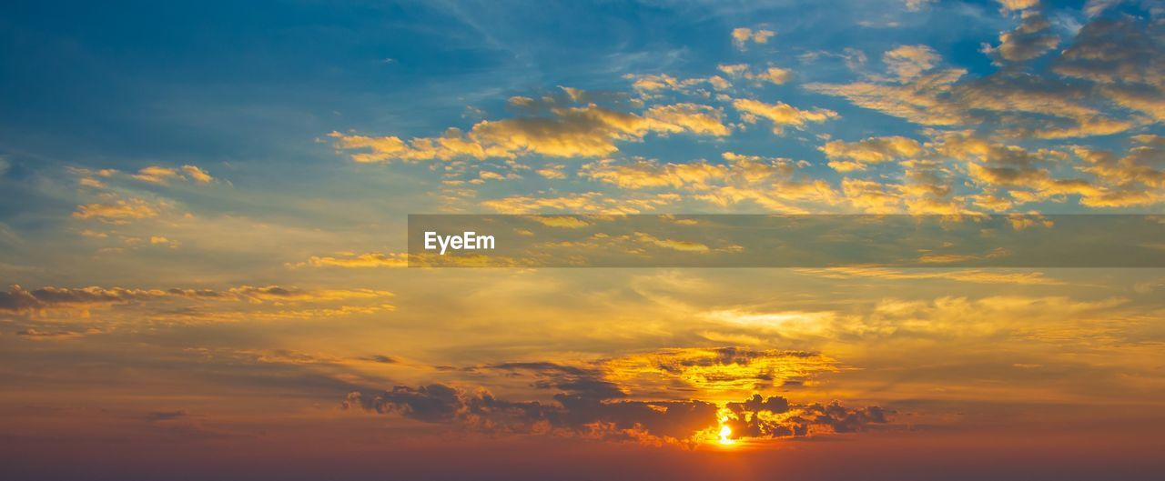 cloud - sky, sky, sunset, orange color, beauty in nature, tranquility, scenics - nature, tranquil scene, nature, idyllic, no people, low angle view, outdoors, dramatic sky, sunlight, yellow, non-urban scene, majestic, cloudscape, environment, romantic sky