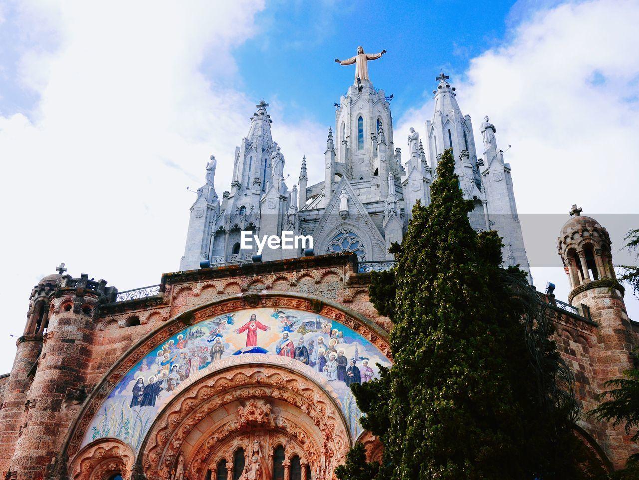 Low angle view of temple expiatori del sagrat cor against sky
