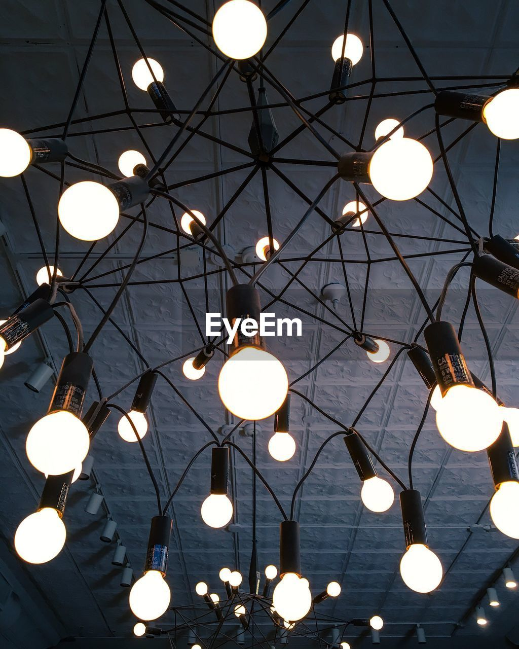 lighting equipment, illuminated, ceiling, low angle view, hanging, light bulb, electricity, no people, indoors, close-up, day