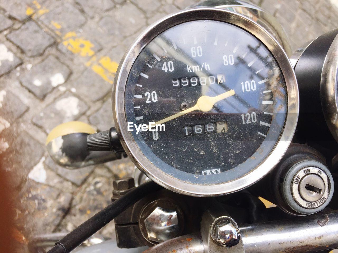 Close-up of tachometer of stationary motorbike