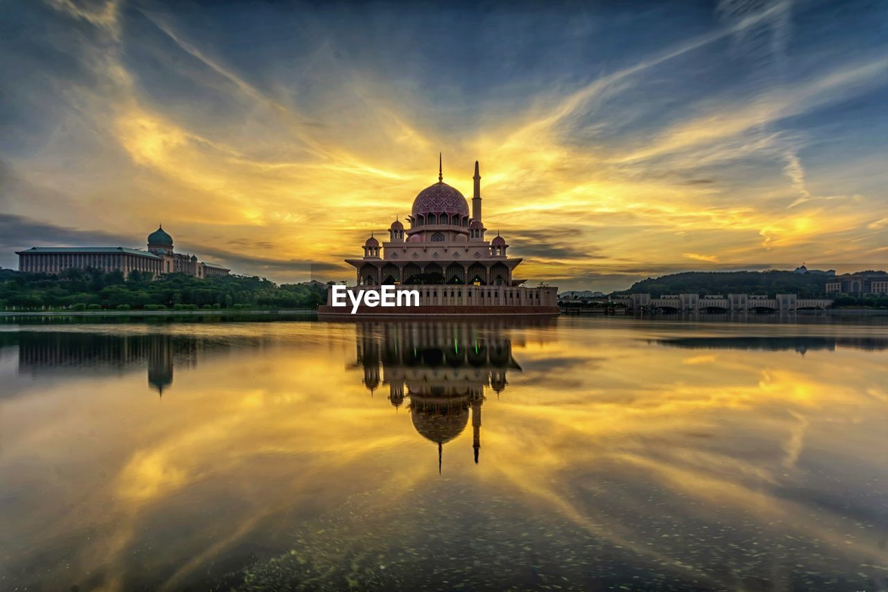 sky, architecture, cloud - sky, building exterior, built structure, water, reflection, sunset, waterfront, dome, religion, belief, building, spirituality, nature, place of worship, travel destinations, tourism, no people, outdoors, government