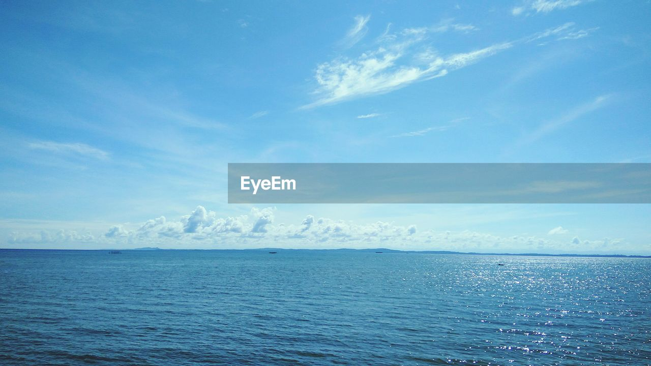 sea, horizon over water, tranquility, scenics, water, tranquil scene, beauty in nature, sky, nature, blue, idyllic, day, outdoors, rippled, no people, cloud - sky