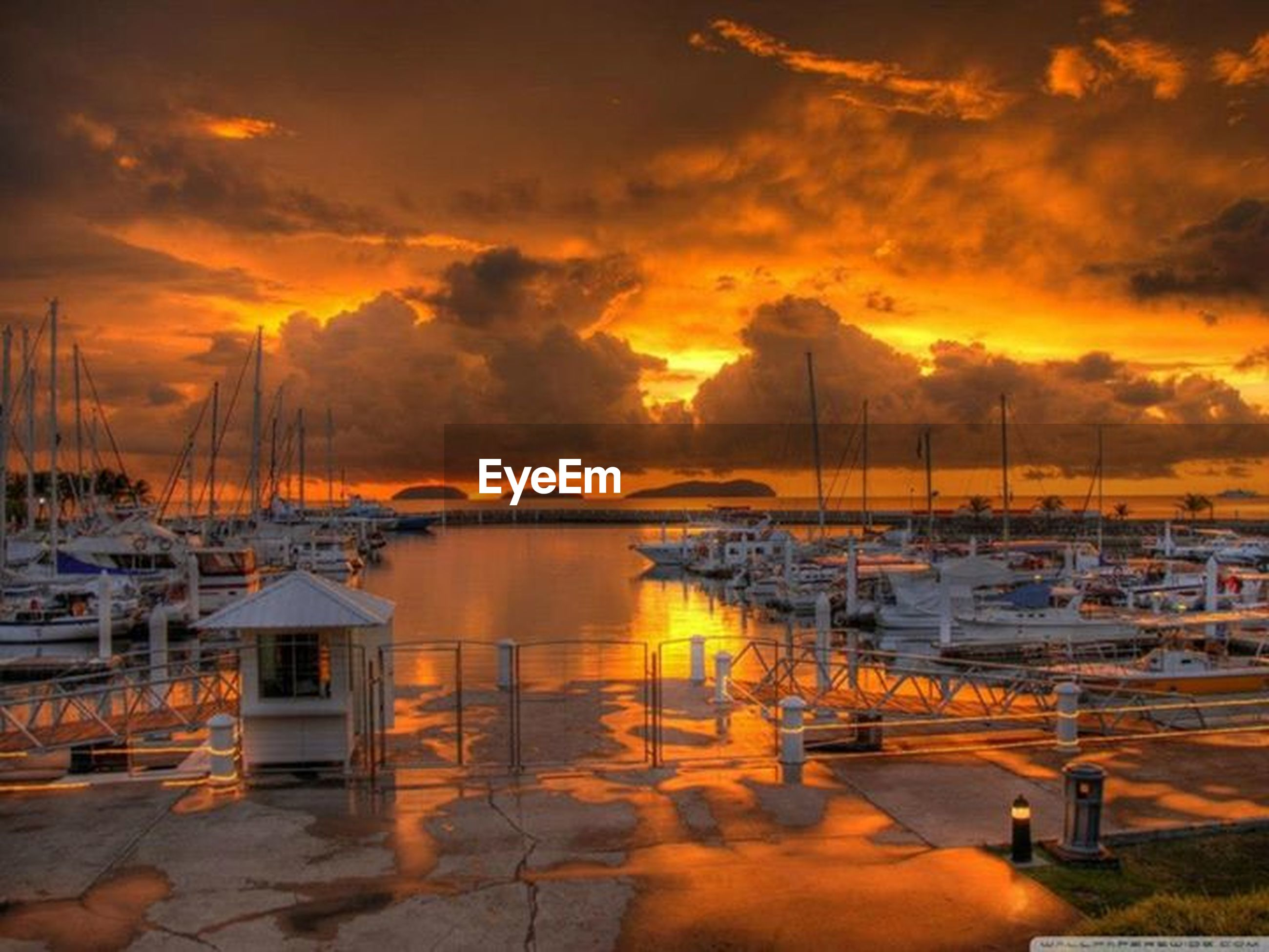 sunset, water, moored, nautical vessel, orange color, sky, transportation, boat, cloud - sky, mode of transport, reflection, sea, harbor, scenics, beauty in nature, tranquility, tranquil scene, nature, lake, cloudy